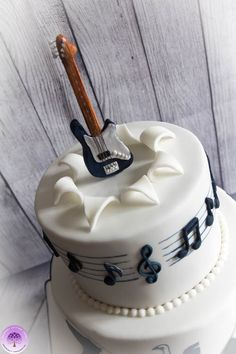 Spurs & Guitar 70th Birthday Cake by Mulberry Cottage Cakes