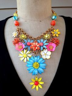 This statement necklace is gorgeous! It is comprised of 15 vintage enamel flower and daisy earrings and brooches. Circa 1960s and 70s, I have removed