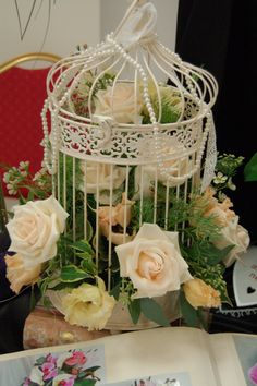 Birdcage table centre in pastel shades with pearl accessories