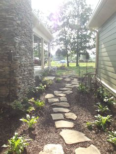 Landscaping with leftover rock from the exterior of the house.