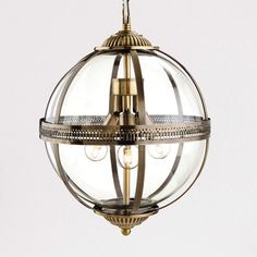 Traditional meets modern with the Mayfair sphere pendant light. Finely detailed antique brass encloses a blown glass globe with three lightsources. Includes antique brass ceiling rose and of chain which can be adjusted to suit on installation. Lantern Pendant Lighting, Bronze Pendant Light, Globe Pendant Light, Modern Pendant Light, Ceiling Pendant, Pendant Lights, Victorian Pendant Lighting, Traditional Pendant Lighting, Antique Lighting