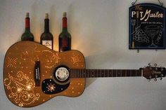 In a fix about what to do with your old, broken guitar? Here are 16 recycling ideas to turn your old guitar into beautiful home decor. Guitar Crafts, Guitar Diy, Porta Dvd, Guitar Decorations, Broken Guitar, Guitar Shelf, Guitar On Wall, Guitar Rack, Deco Luminaire