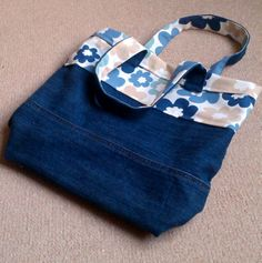 Tote bag from old pair of jeans and a piece of Clarke and Clarke fabric.