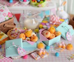 Nestled in a shabby pastel tin, these Easter doughnuts are ideal for your holiday scene! Included in this assortment are 2 glazed, 2 baby chick cream filled, 1 doughnut topped with jelly beans, 1 buttercream frosted doughnut, 3 bunny butt doughnuts and a buttercream frosted éclair. Two Easter napkins with a cute bunny design complete this set.  **PLEASE NOTE: Two doughnut tins currently available. Price is per tin. Pink gingham paper not attached to tin. Doughnuts are loose. Éclair frosting…