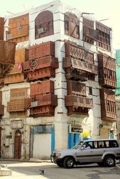 "ARABIAN  Mashrabiya (Shanasheel) windows in Jeddah, Saudi Arabia.  - ""The mashrabiya emerged from the practice of cooling pots of drinking water in an enclosed wooden shelf by the window. The latticework and the projected bay allowed cooling winds to pass into the interior while filtering out the hot afternoon sunlight."" -Kalpana Gurung"