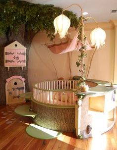 Simply wonderful enchanted forest feel. Love the tree furniture!