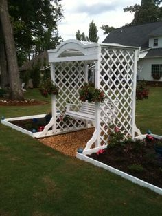 ARBOR SWING WITH RAISED BEDS ADJACENT THAT I CREATED, PAINTED AND AM STILL WORKING ON FILLING DUG DOWN 12 INCHES AND FILLED WITH GRAVEL FOR SWING AREA AND LEVELED BACK BREAKING BUT GRATIFYING PROJECT