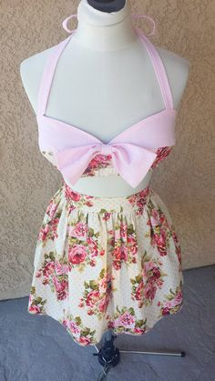 Pinup Vintage style Playsuit 2 piece set Adorable floral and pink stripe print Bandeau halter top Front bow embellishment Fully lined with side boning and lightly padded. Matching High waist floral gathered flare Skirt back zipper closure  Rockabilly Pinup girl french country floral country girl  shabby chic playsuit retro vintage 50s inspired.