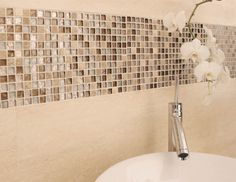 Mini Mix Mosaic: Small pieces of glass mosaic mixed with coordinating natural stone mosaic bring your walls alive with texture and light. Choose from blends of black and white, brown, beige and iridescent grey. Try contrasting a black Mini Mix Mercury border with white bathroom tiles for a truly contemporary look. View range: http://www.decorumtiles.co.uk/product-category/mosaic-tiles/mini-mix/