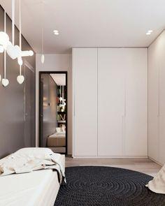 Dark wall tiling wood bedroom wardrobe white round carpet