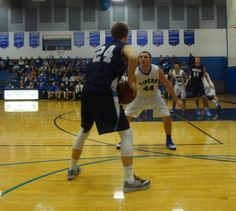 BASKETBALL: Tigers can't hold off Theisen and Roncalli, lose 65-58.
