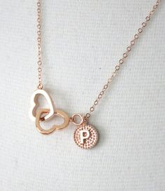 Double Heart Infinity charm together with an initial pendant comes on a delicate dainty rose gold filled chain. Simple and great way to tell your loved ones  I love you forever and ever.  Easy to stack with other necklaces and goes with everything in your wardrobe.  ✦ Infinity: 1 inch ✦ Chain: Rose Gold Filled ✦ Length: Please choose from the length option.  ✦ Beautifully gift wrapped in a gift box with a ribbon.  ♥ Do visit Color Me Missy for more. http://www.colormemissy.etsy.com…