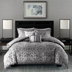 The Elena Comforter Set provides a bold new statement in your space. A rich charcoal is woven with a silver metallic creating this glamorous geometric medallion motif.