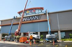 """Members of I-5's installation crew installing the exterior façade for the Oaklawn Racing & Gaming facility. The """"Oaklawn"""" channel letters and the """"silk's"""" logo cabinets are internally illuminated . The structure behind the signage is aluminum framewo Learn how you can make money from horse racing"""