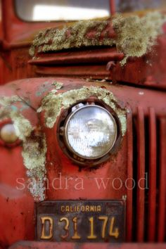 a time worn old friend red truck rusted. I'd like to have that license plate for my collection!