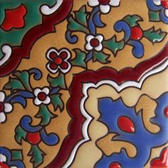 """Made To Order Relief Tile """"Houston"""" Relief tiles with blue and red design painted over brown background. #mycustommade"""