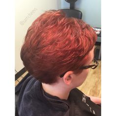 Red orange hair color with pixie hair cut