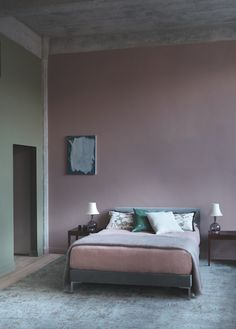 olour from Paint and Paper Library works well with green for a modern bedroom interior design scheme.