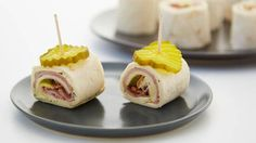 Bacon Cuban Roll-ups. You've never had a ham and cheese roll-up like this! We've layered cream cheese, ham, bacon and Swiss cheese together for a quick make-ahead appetizer people will ask for again and again. (Don't forget the pickles. Potluck Appetizers, Make Ahead Appetizers, Quick Appetizers, Appetizer Recipes, Appetizer Ideas, Dinner Recipes, Christmas Appetizers, Potluck Recipes, Ham And Cheese Roll Ups