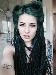 Long dark green hair. Id love to be able to do those curls.