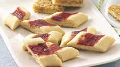 Split Seconds - - These jelly-filled sugar cookies are as pretty as thumbprints but much simpler to make. Bake Off Recipes, Cookie Recipes, Dessert Recipes, Wrap Recipes, Recipes Dinner, Keto Recipes, Sugar Cookie Icing, Best Sugar Cookies, Bake Off Winners