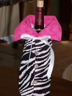 Zebra wine bottle bag. If you're going to give the gift of wine why put it in a paper bag??