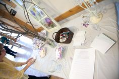Fairy Tale themed Bridal Shower: wish tree...in top right corner it's hard to see there is a candle holder, glass slipper, and fairy god mother dust.; purple & white