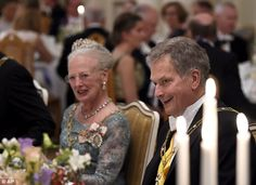 Queen Margrethe of Denmark sits alongside the President of Finland, Sauli Niinist, at the dinner table