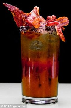 Would you drink a #bacon cocktail? Forget olives and paper umbrellas, these days it's all about drinks with the crispy meat garnish.