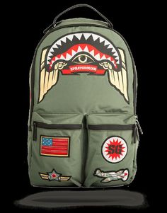 Designer: Spray Ground Color: Green Retro military feel with an updated silhouette. The army shark patches backpack plays off of original military-inspired unif Trendy Backpacks, Green Backpacks, Kids Backpacks, Bape, Fashion Bags, Fashion Backpack, Women's Fashion, Backpack Online, Green Bag