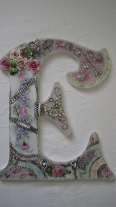 Jeweled broken China Mosaic letter - on perspex? by wendy
