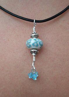 Light Blue on White Handmade Lampwork Pendant Necklace. $19.99, via Etsy.