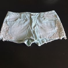 Mossimo shorts Missimo light wash denim cutoff shorts, white lace detail. Size 11. Mossimo Supply Co. Shorts Jean Shorts