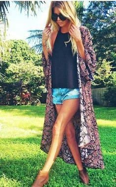 Black shirt, long printed Kimono, jean shorts, and brown booties