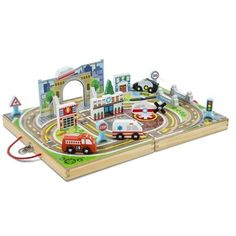 The Melissa & Doug Take-Along Town has built-in tracks, colourful scenery and fun play pieces that let kids take their imaginations for a spin . and take playtime anywhere they want to go! Arty Toys, Wooden Playset, Melissa & Doug, Knitting Supplies, Wooden Case, Sewing Art, Oriental Trading, Kids Playing, Kids Toys