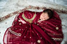 beautiful newborn session with mom's wedding sari