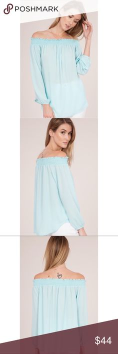 New oversized blue lightweight Off Shoulder top 100% polyester. Made in the USA Tops Blouses