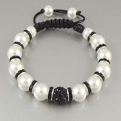We're taking the Shamballa bracelet to the next level! This beautiful handmade bracelet features an Austrian crystal Shamballa bead with 12 faux pearl beads le