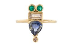 Gemstone Spotlight: Mociun. This ring is set with a 1.32-carat pear-cut bicolor sapphire, a 0.31-carat white diamond baguette, a 0.03-carat champagne diamond and two emeralds weighing 0.09 carats each in 14-karat yellow gold ($5,000).