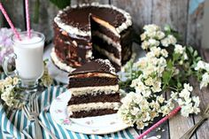Chocolate Brownie Cake that is indulgent and rich, with layers of vanilla mascarpone buttercream, coconut walnut custard and chocolate ganache.