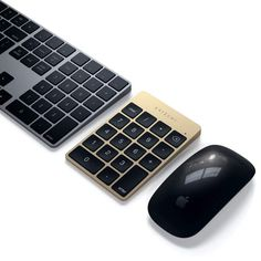 The Satechi Aluminum Slim Bluetooth Keypad completes your work setup, offering both style and functionality with a slim and sophisticated design. Computer Keyboard, Bluetooth, Phones, Tech, Slim, Design, Technology, Computer Keypad, Design Comics