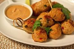Kathy Casey's Lemon Grass Chicken Meatballs With Sassy Peanut Sauce... Featured in @The Seattle Times - Kathy Casey recommends this recipe as a do-ahead appetizer for a party. Meatballs are often a hit, but she spiced these up to add a bit more interest. Photos by Kathy Casey Food Studios® Find more at kathycasey.com #appetizers #holiday #barchef