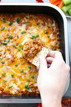 Hosting a party for the big game? This healthy chili cheese dip will be loved by everyone. It's especially good with a chip!