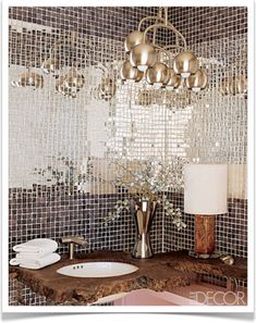 Mirror tiled bathroom. I LOVE this!!! For a small powder room .