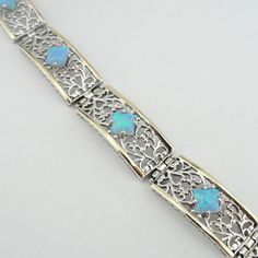 Handcrafted filigree bracelet in 9K gold, sterling silver and opal by jewela at Etsy