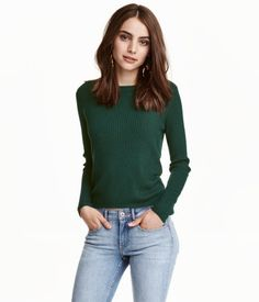 Emerald green. Soft, rib-knit sweater with long sleeves.