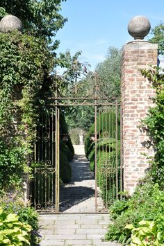 ✽    old iron gate  -  ball-topped brick pillars