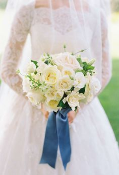 A white bouquet iwth David Austen roses, spray roses, gardenia, and larkspur | Brides.com