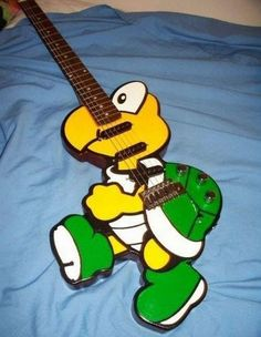 Koopa Troopa Guitar - my 3-year old would lose it - his two favourite things are guitars and being Koopa Troopa in Mario Kart