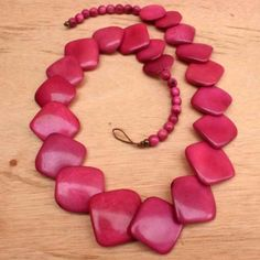 Check out this necklace: Eco-friendly materials; Fair trade and handmade, direct to you from Ecuador. $58.00 http://www.artisansintheandes.com/beaded-necklaces-bib-necklace-chunky/beaded-necklaces-pink-tagua-chunky-square